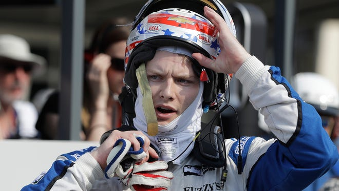 Josef Newgarden takes off his helmet following his qualifying run for the Indianapolis 500 on Sunday, May 22, 2016.