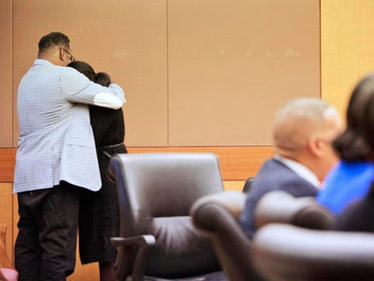 LaPrincia Brown, right, the half-sister of Bobbi Kristina Brown, is comforted by their father Bobby Brown, after taking the witness stand in a wrongful death case against Bobbi Kristina's partner, Nick Gordon, in Atlanta, Thursday, Nov. 17, 2016. Bobbi Kristina Brown was found face-down and unresponsive in a bathtub in her suburban Atlanta townhome in January 2015.