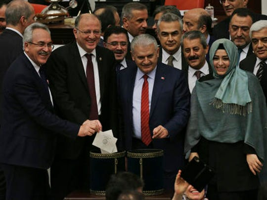 Turkey's Prime Minister, Binali Yildirim, centre, accompanied