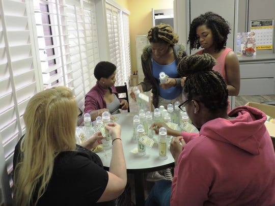 Mary's Shelter residents Jessica, left, Jasi, Samantha, Valencia and Rai work on a fundraising project as part of the volunteer hour commitment at the shelter.