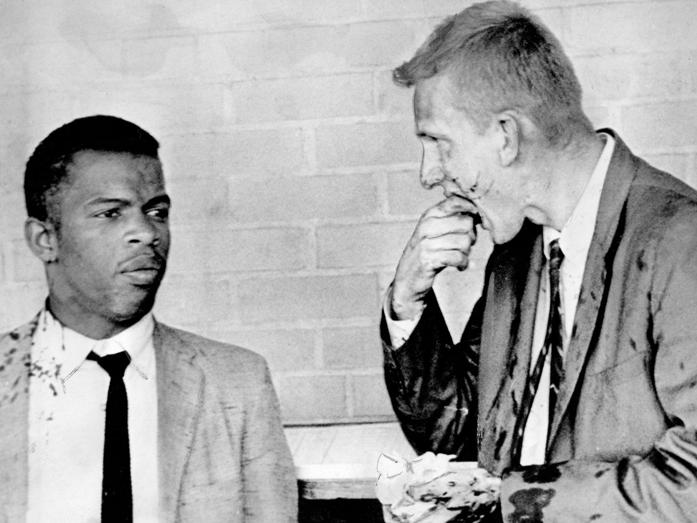 Freedom Riders John Lewis, left, now a Georgia congressman, and Jim Zwerg, then a Fisk student, were beaten by a mob in 1961 after they arrived in Montgomery, Ala.