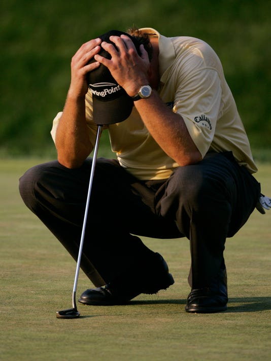 FILE - In this June 18, 2006, file photo Phil Mickelson reacts after double-bogeying the 18th hole in the final round of the U.S. Open golf tournament at Winged Foot Golf Club in Mamaroneck, N.Y. No one has suffered more at the U.S. Open than Mickelson, who holds the record with six runner-up finishes and lacks only this title to complete the career Grand Slam. (AP Photo/Charles Krupa, File)