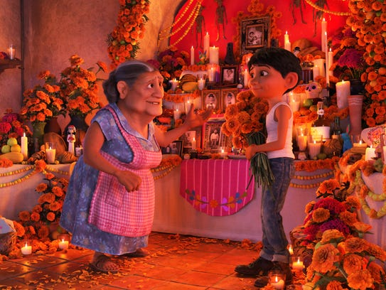 Abuelita (voiced by Renée Victor, left) and Miguel