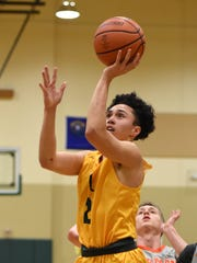 Manogue's Gabe Bansuelo shoots against Bishop Gorman in the Wild West Shoot Out tournament at Bishop Manogue  on Nov. 30, 2017.