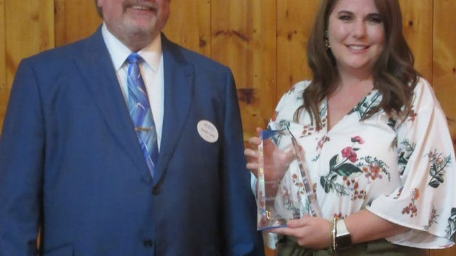 Ashley Centofonti (right) was recognized as Mineral County's Young Professional as the Mineral County Chamber of Commerce held its annual Summit Awards. Shown presenting her award is chamber president Randy Crane. Tribune photo by Ronda Wertman