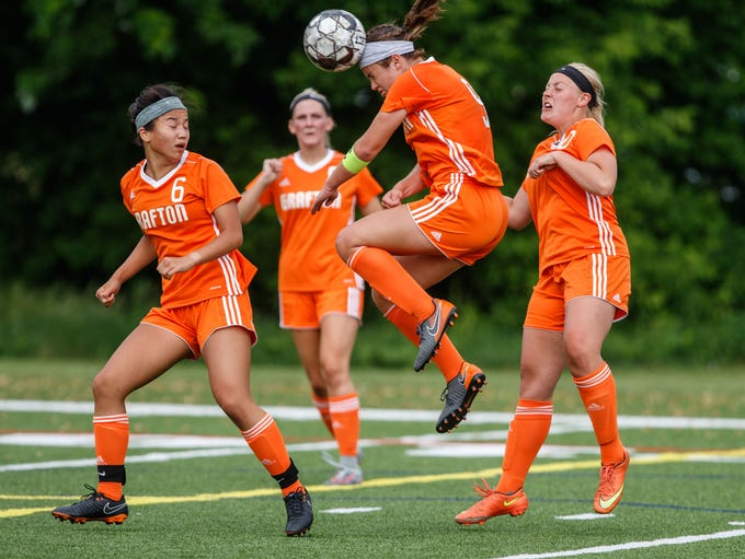 Grafton junior Haily Block (9) elevates for a header