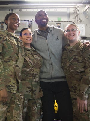 NBA legend Rip Hamilton poses with military members during a 2018 USO tour.