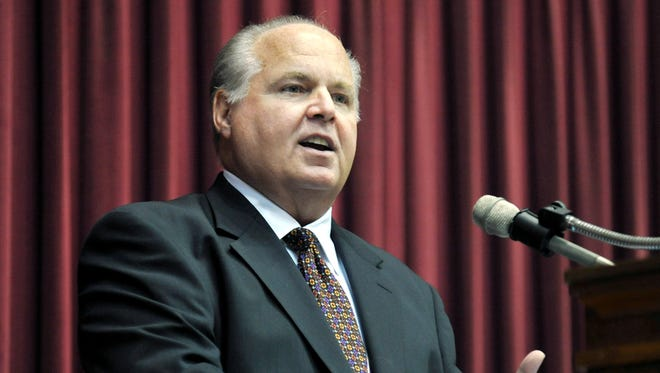 Conservative commentator Rush Limbaugh speaks during a ceremony in 2012.