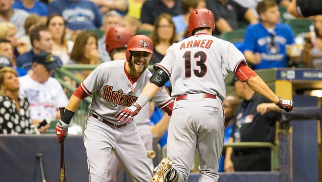 May 29, 2015: Arizona Diamondbacks shortstop Nick Ahmed (13) is congratulated by pinch hitter Addison Reed (43) after hitting a home run during the eighth inning against the Milwaukee Brewers at Miller Park.