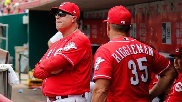 Cincinnati Reds manager Bryan Price (38) talks to Cincinnati Reds bench coach Jim Riggleman (35) in the dugout, Thursday, July 20, 2017, at Great American Ball Park.