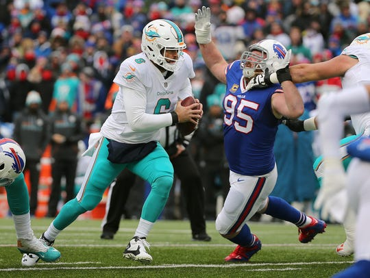 Dolphins quarterback Jay Cutler is pressured by Bills