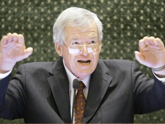 FILE - In this March 5, 2008, file photo, former U.S. House Speaker Dennis Hastert speaks to lawmakers on the Illinois House of Representatives floor at the state Capitol in Springfield, Ill. Federal prosecutors have indicted Thursday, May 28, 2015, the former U.S. House Speaker on bank-related charges.