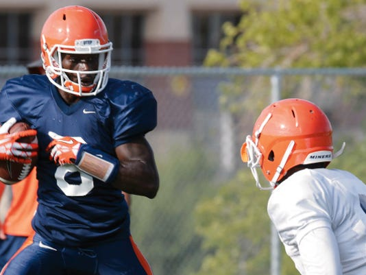 UTEP senior Autrey Golden looks to make a move on a defensive player after catching the ball during practice Wednesday at Glory Field. Golden and the Miners are preparing for their season opener Saturday at Arkansas.