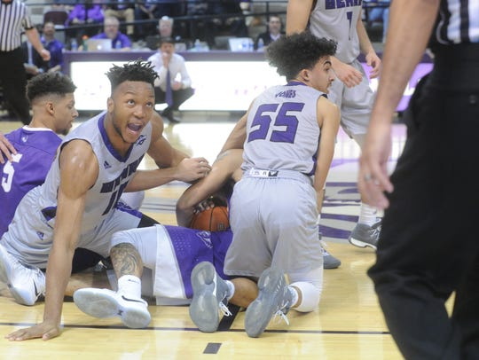 Central Arkansas' Matthew Kamba looks to an official