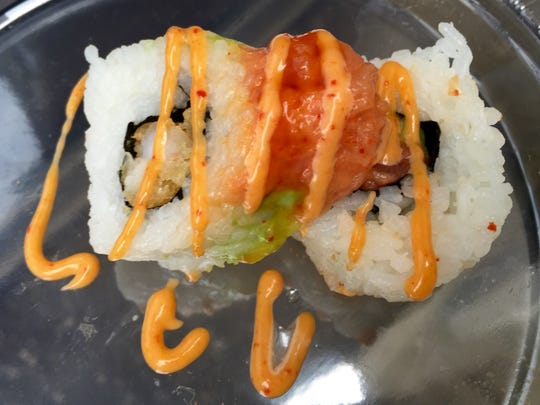 Remlik's in Binghamton served pieces of spicy tuna roll and Remlik's roll during the Roberson Wine & Food Fest.