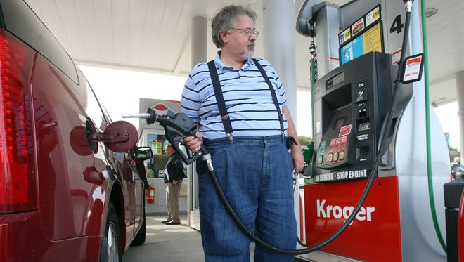 Steve Coghill of Fort Thomas fills up at the gas station at the Newport Pavilion Kroger Marketplace.