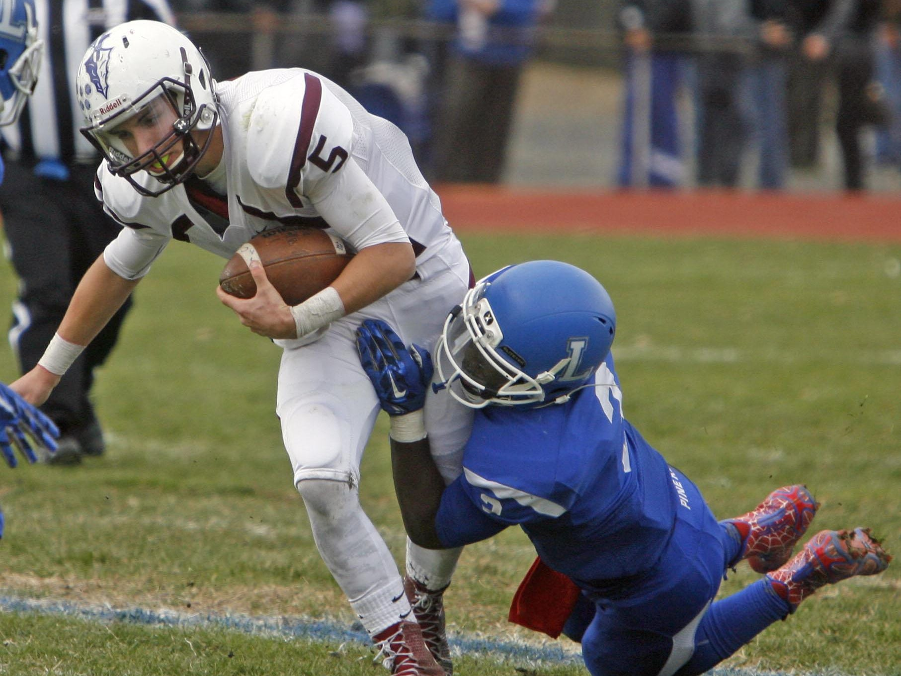 Toms River South quarterback TJ Scuderi is sacked by Lakewood's Jaqel Hunter at Lakewood High School Nov. 26, 2015. Photo by Vincent DiSalvio / Special to The ASBURY PARK PRESS