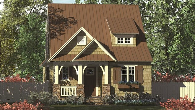 Shingles, stone, and a porch with graceful columns contribute to the home's classic Bungalow style.