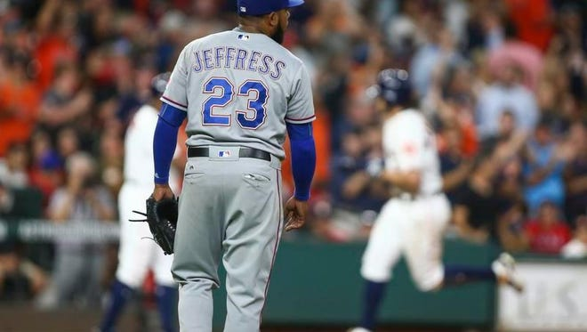 Texas Rangers relief pitcher Jeremy Jeffress (23) reacts and Houston Astros center fielder Jake Marisnick (6) rounds the bases after hitting a home run during the sixth inning at Minute Maid Park.