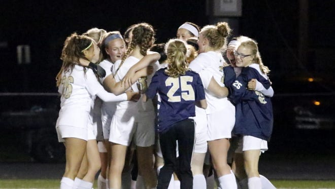 Notre Dame players celebrate their 2-1 win over Little Falls on Nov. 3 at Corning Memorial Stadium.