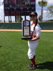 Jaylene Ignacio poses with the 2014 Mountain West Softball Championship trophy. Ignacio is the granddaughter of Eddie Aguon, a former Guam Major League player.