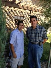 Kevin Chavez, left, with FBI Agent Art Balizan, who