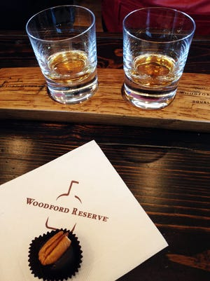 A bourbon chocolate candy and two samples of Woodford Reserve bourbon — Distillers Select (left) and Double Oaked — are provided to visitors at the conclusion of a tour.