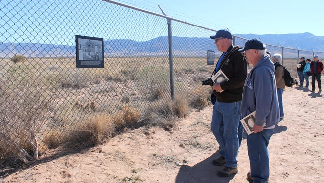 Visitors stop to read a plaque at the Trinity Site Saturday morning to learn more about the atomic bomb.