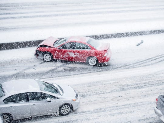 In a winter accident, try to get your vehicle off the road if you can, or turn on your hazard lights and stay inside until help arrives.