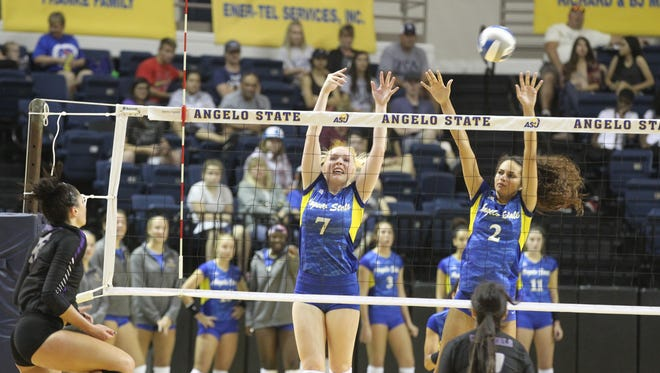 Angelo State University's Abbie Lynn (7) and Morgan Seaton go up for a block against New Mexico Highlands at the Kathleen Brasfield Invitational at the Junell Center on Saturday, Sept. 2, 2017.