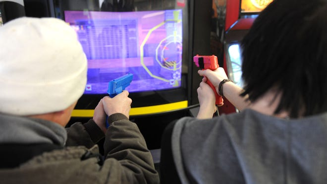(left to right) Mathew Hall and Jaden Hall play Virtua Cop at Geeksters Tuesday afternoon. Geeksters hours are 11 a.m. to 7 p.m. Tuesday through Saturday.