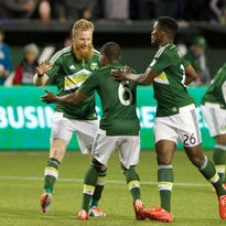 Apr 4, 2015; Portland, OR, USA; Teammates celebrate the Timbers' first goal by  Portland Timbers defender Nat Borchers (7) against FC Dallas at Providence Park. Mandatory Credit: Jaime Valdez-USA TODAY Sports