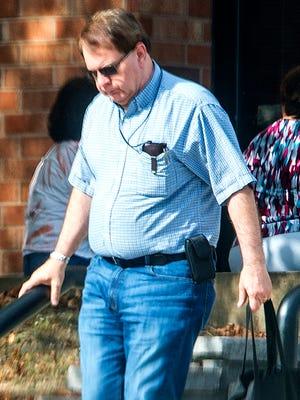 Ronald Langer leaves the state office building in Endicott on Sept. 25.