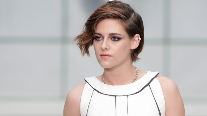 Actress Kristen Stewart poses for photographers  as she arrives for Chanel 's Spring-Summer 2015 Haute Couture fashion collection, presented in Paris, France.