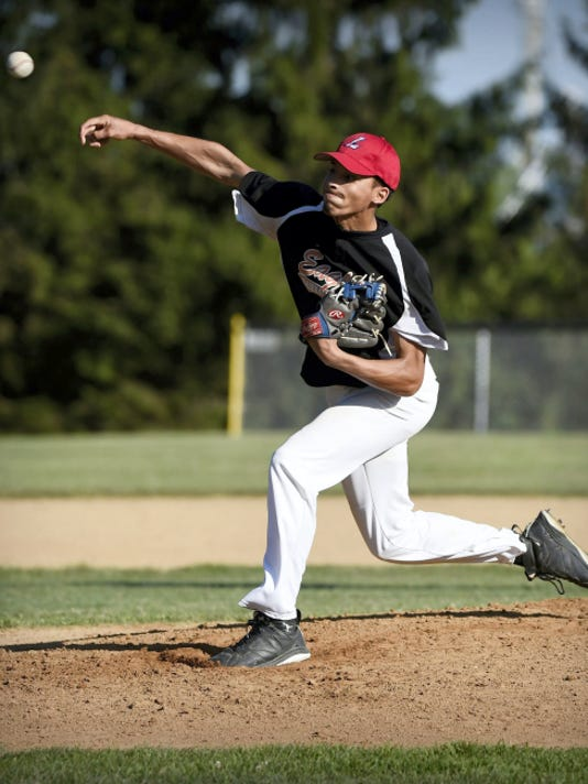 Lebanon City's Michael Deleon (21) pitches during a 7-5 win against Lebanon Valley Thursday evening at 5th Ward Athletic Club.