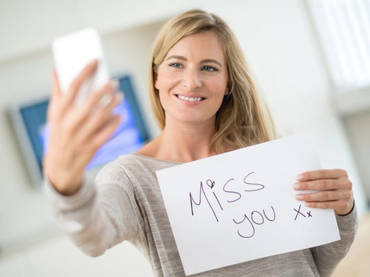 Woman talking on web chat through her phone