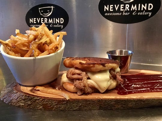 The Pork Belly Grilled Cheese is $14 at Nevermind in Cape Coral.
