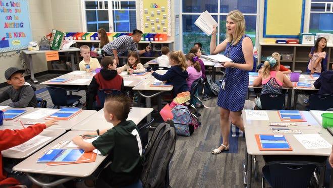 Teacher Stephanie Sexton walks around her Pearson classroom on Tuesday and begins to organize their first day.