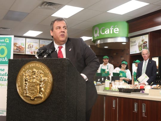 Governor Chris Christie came to a newly opened QuickChek in Cedar Knolls to tout job growth and positive economic news in New Jersey. Behind him is Dean Durling, CEO of QuickChek.