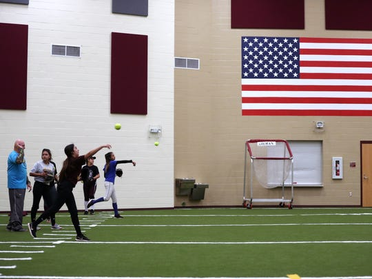 Tuloso-Midway High School students try out for the softball team on Friday, January 19, 2018 on what was the first day of softball practice.