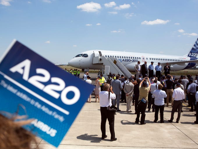 Members of the media record images of an Airbus A220