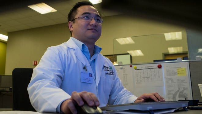 Arvin Santos, M.D. works at his computer on Friday, May 4, 2018 at Avera eCare in Sioux Falls, S.D.