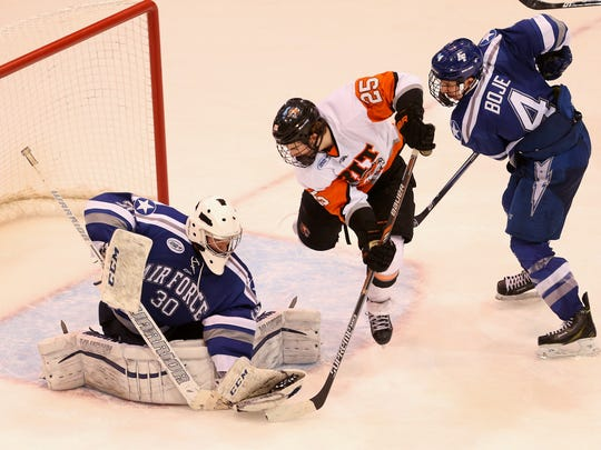 """RIT's Josh Mitchell, shown here charging to the goal mouth in the 2015 playoffs against Air Force, says playing in front of 10,000 fans in the Brick City Homecoming game is """"something special."""""""