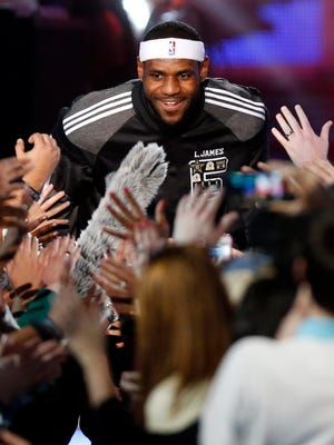 LeBron James greets fans after being introduced at the NBA All-Star Game.