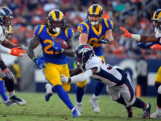 Running back Darrell Henderson, left, is entering his rookie season with the Rams.