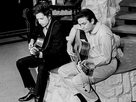 Bob Dylan, left, rehearsal with Johnny Cash on the stage of the Ryman Auditorium May 1, 1969 before a taping of the Johnny Cash show.