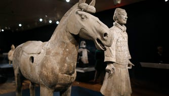 A cavalryman and horse in the new Terracotta Army: Legacy of the First Emperor of China exhibit at the Cincinnati Art Museum in the Mount Adams neighborhood of Cincinnati on Thursday, April 19, 2018.
