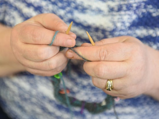 Marcie Brink-Chaney works on one of her current knitting projects at the ...Have You Any Wool store in Berkley