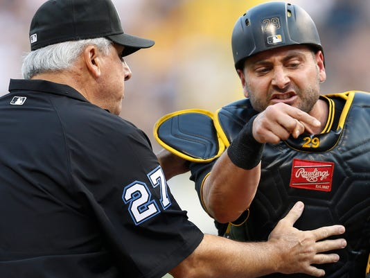 Pittsburgh Pirates catcher Francisco Cervelli, right, argues with second base umpire Larry Vanover after home plate umpire Vic Carapazza ejected Cervelli from the baseball game against the St. Louis Cardinals during the second inning of a baseball game, Saturday, July 11, 2015, in Pittsburgh. Manager Clint Hurdle was then ejected after continuing the argument. Cervelli was ejected after Cardinals' Mark Reynolds hit a home run after Cervelli complained about a pitch the umpire called a foul tip on the previous pitch. (AP Photo/Keith Srakocic)