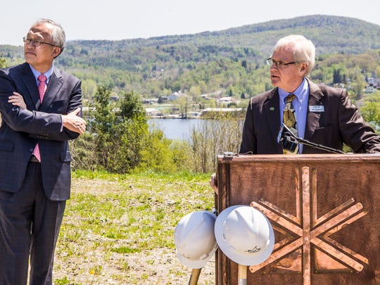 Bill Stenger, at podium, and Dr. Ike Lee, AnC Bio CEO, at the groundbreaking ceremony for the new biotech facility in Newport. The project was caught up in an alleged fraud and never got underway.